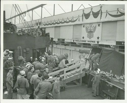 Soldiers leaving a transport ship at the Los Angeles Port Embarkation, Wilmington, California - Page