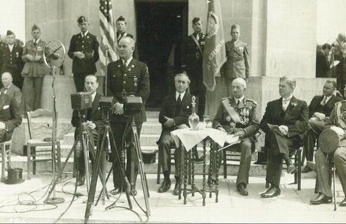 Harry Walter Colmery, American Legion Commander, speaking at the dedication of the Flanders Field Chapel, Waeregham, Belgium. - Page