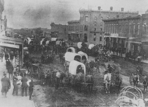 Covered wagons on the streets of Caldwell, Kansas - Page