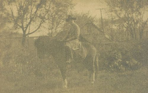 Snapshot of Mary White on a horse