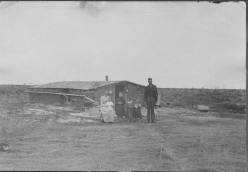 Unidentified family standing in front of a sod house, Finney County, Kansas - Page