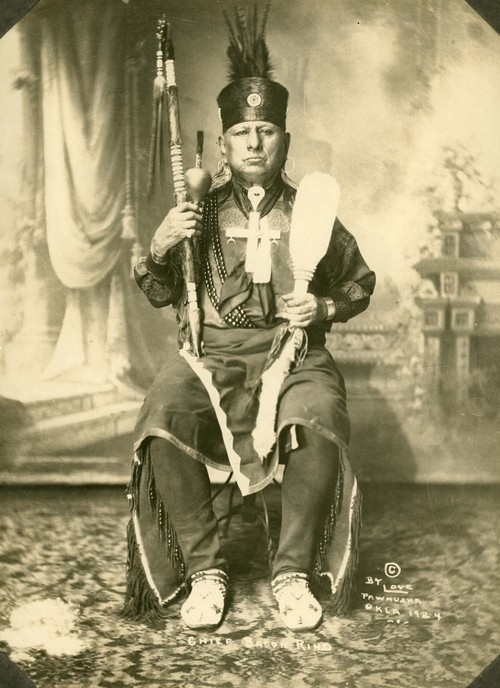 This Photograph of Chief Bacon Rind was taken in 1924. He was a tribal council member, served as assistant chief during 1904 and 1905, and was elected principle chief in 1912. The United States Secretary of the Interior, Walter L. Fisher removed him as principle chief in 1913 over an incident involving an oil lease. Bacon Rind was still recognized as a leader by the Osage after his removal. For the last 25 years before his death in 1932, he represented the tribe on annual visits to Washington D.C.  He was a progressive political leader that supported the development of oil and natural gas resources on the reservation. He was also a cultural traditionalist and Osage language speaker.