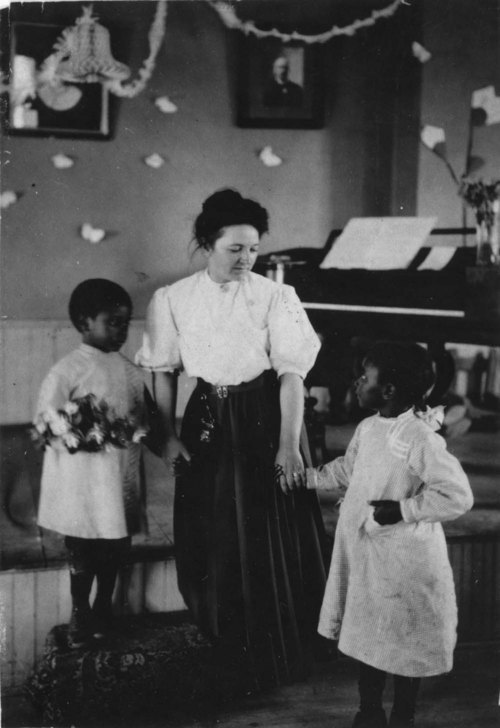 June Chapman with students - Page