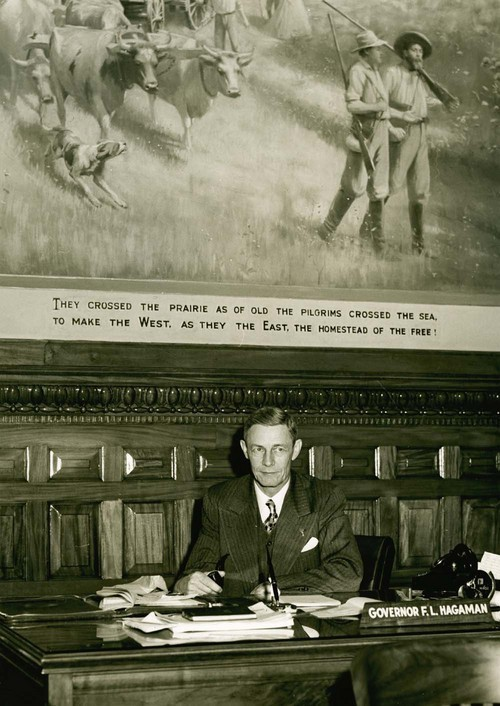 Frank Leslie Hagaman, seated at the governor's desk. - Page