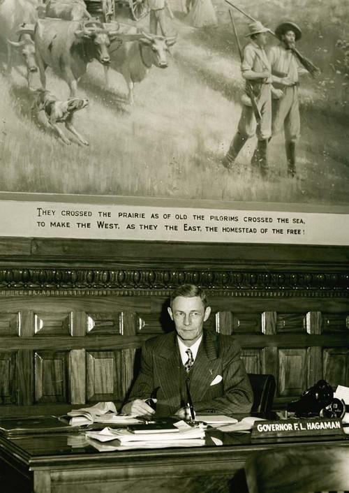 Frank Leslie Hagaman at governor's desk - Page
