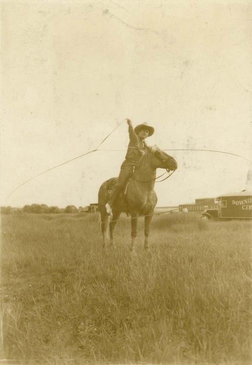 Reb Russell performing his rope twirling act - Page