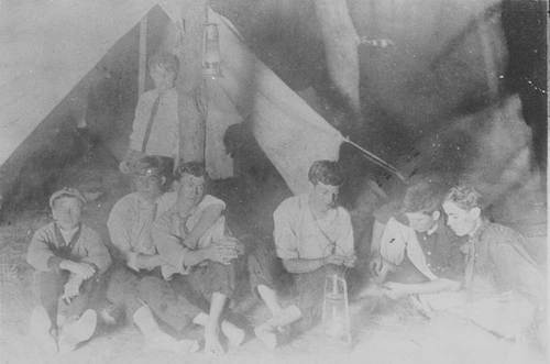 Dwight David Eisenhower camping with a group of boys. - Page