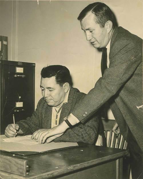 Rufino Garcia signing his G. I. Bill paperwork - Page