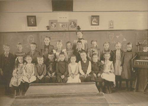 Photograph of an interior of the Herkimer School in Marshall County, 1900s.