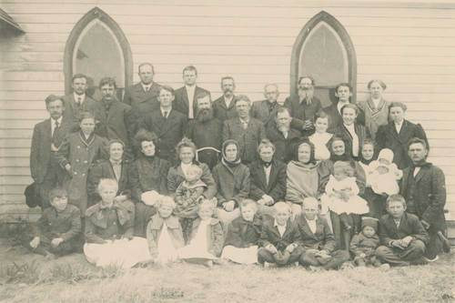 Early settler families outside of church - Page