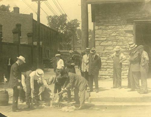 Rev. Charles Monroe Sheldon and Rev. Benjamin Young disposing of liquor - Page