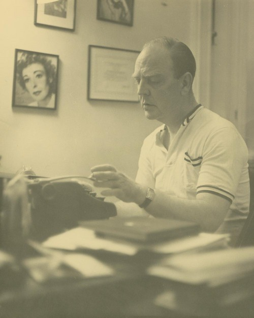 Photograph of William Inge taken at the typewriter, 1950s