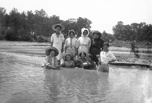 Women wading in water in Sedgwick County