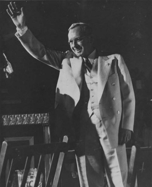 Photo of Alf Landon waving to a crowd, taken in Topeka, Kansas, August 1, 1936.