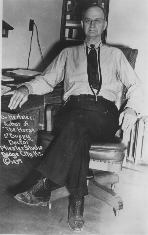 Photo of Dr. Arthur E. Hertzler sitting at his desk at the Hertzler Hospital