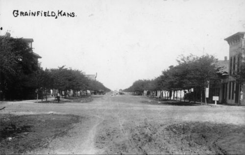 Photo of an unidentified street in Grainfield with some buildings in view, between 1900 and 1930.
