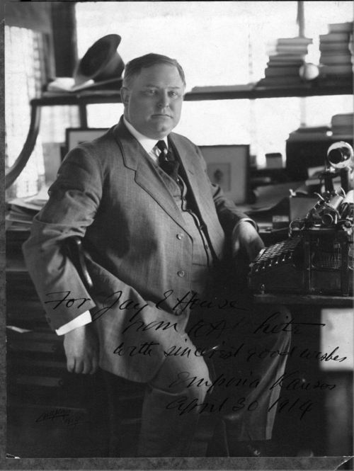 Photograph of William Allen White seated at his desk, 1914.