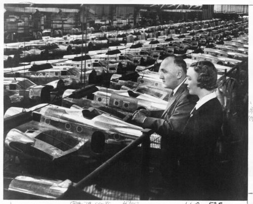 Walter and Olive Ann Beech viewing World War II aircraft production lines at the Beechcraft Plant I in Wichita