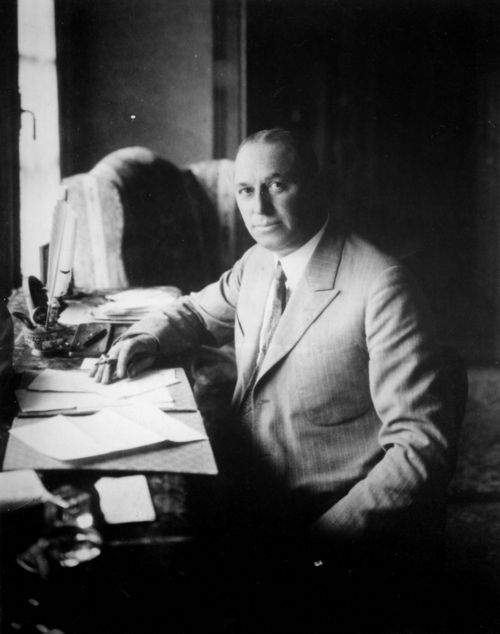 Photograph of Walter Percy Chrysler, 1875-1940, seated at a  desk in his home, 1924.