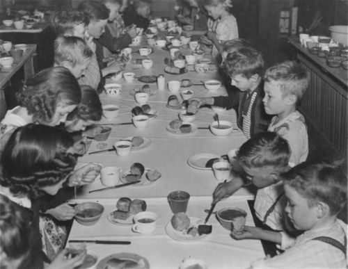 Photo of children eating a school lunch in Garland, between  1939 and 1943.