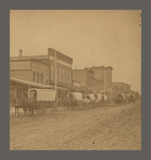 Covered wagons on Kansas Avenue, Topeka, Kan. - Page