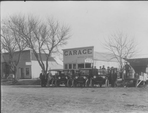 Photo showing automobiles parked in front of James Buck's Dodge Motor Car Company and Garage building in Atwood, 1910s