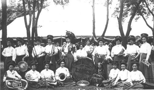 Photo of Helen May Butler and Her Ladies Brass Band with their instruments at Chautauqua in Sabetha, 1909