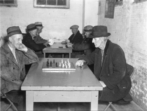 Men playing chess and cards - Page