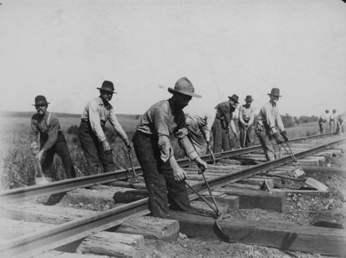 Section gang replacing railroad ties - Page