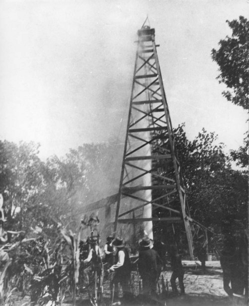 This photograph shows a water spout shooting 100 feet in the air at Norman #1, a discovery oil well in the Mid-continent oil field near Neodesha, Kansas, 1893.