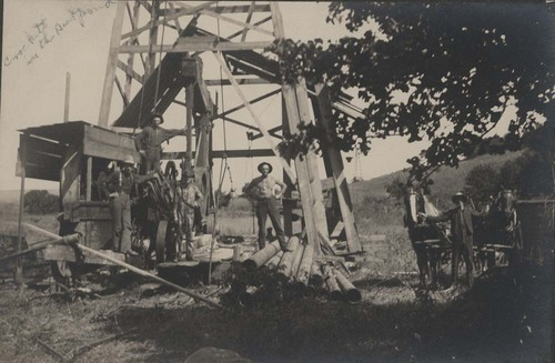 Unidentified men at an oil well, Peru, Kansas - Page