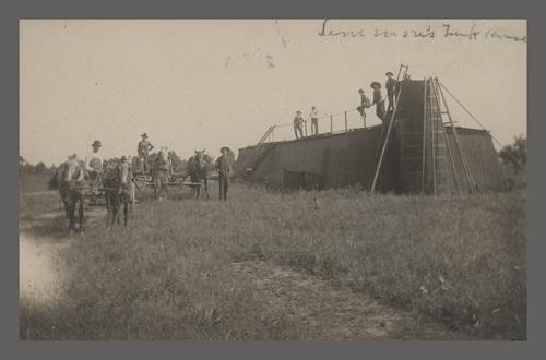 Unidentified men in an oil field, Peru, Kansas - Page