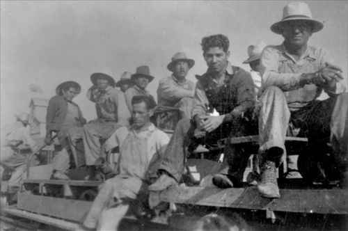 Photo of Atchison, Topeka & Santa Fe Railroad section crew consisting of Mexican American workers, between 1925 and 1935.