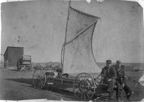 Photograph showing George Bull and Clint McIntosh with a wind wagon, Logan County, 1890s.