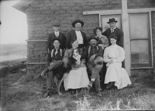 Settlers in front of a sod house - Page