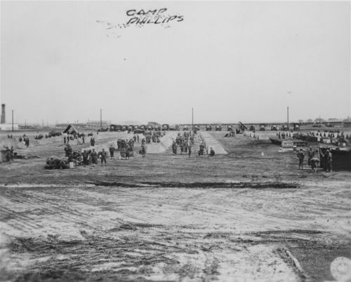 A photo of soldiers being inspected outside of their tents at Camp Phillips, Salina, during World War II.