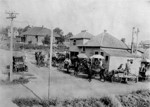 A view of the busy De Soto Creamery in De Soto, between 1900 and 1919.