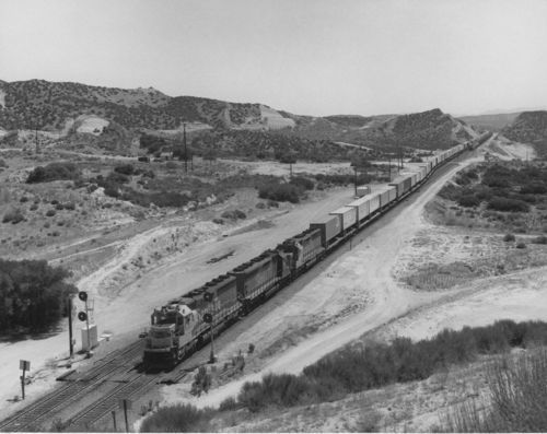 Diesel-powered locomotive and piggyback freight train, Cajon Pass, California - Page