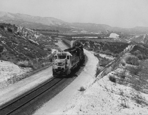 Diesel-powered locomotive and chemical train, Cajon Pass, California - Page