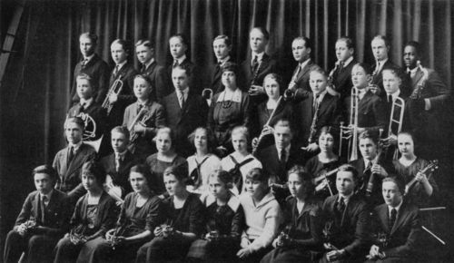 Portrait of the members of the 1920-1921 Topeka High School Orchestra. Coleman Hawkins is on the right in the top row.