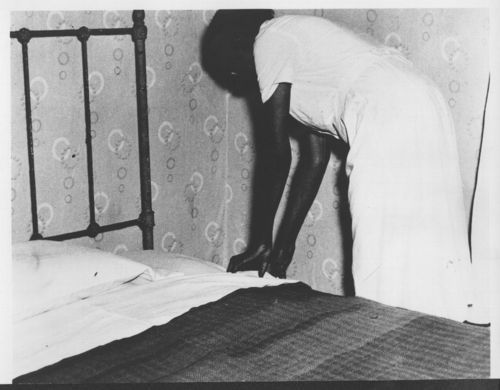 Woman making a bed - Page