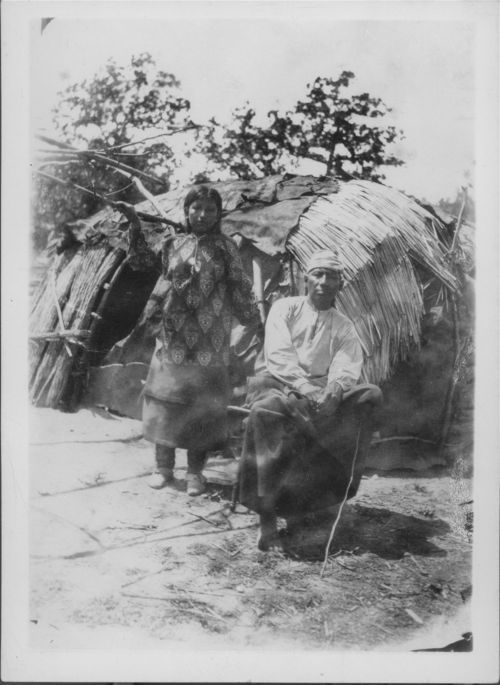 This Osage couple was photographed in front of a lodge during the 1880s.