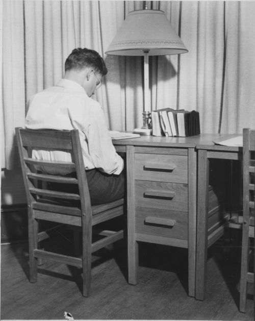 Man seated at a desk - Page