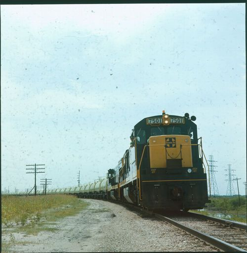 Atchison, Topeka & Santa Fe Railway freight train pulled by engine #7501. - Page