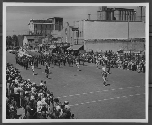 Image of Russell High School band marching in a Prairiesta Parade in Russell, 1950s.