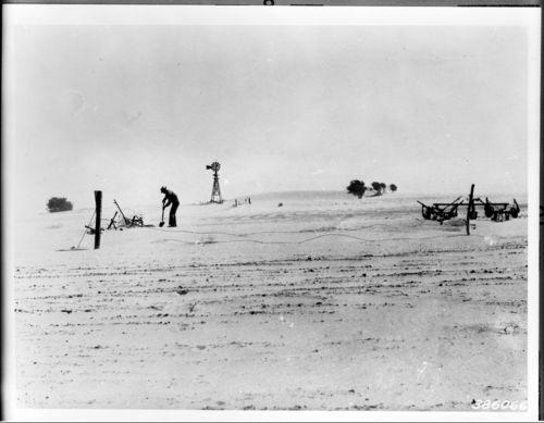 Farmer shoveling heavy dust - Page