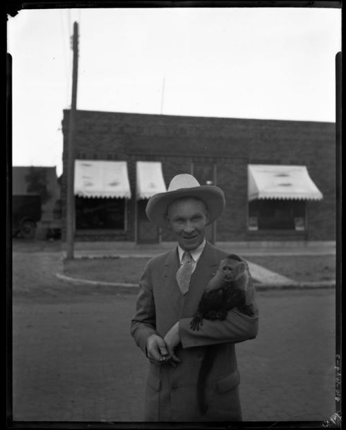 Man with monkey, Marysville, Kansas - Page