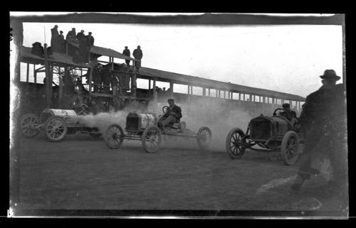 A photograph showing three automobiles racing on a dirt track in Marshall County, Kansas, between 1911 and 1914.