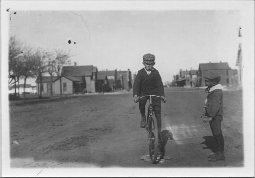 Riding a bicycle, Russell, Kansas - Page