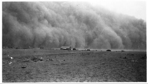 A photograph showing an approaching dust storm in Morton County, Kansas, ca. 1935.